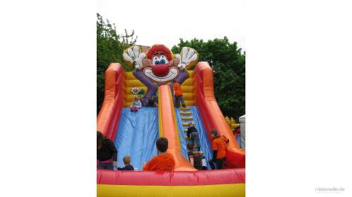 Hüpfburg Clown Rutsche