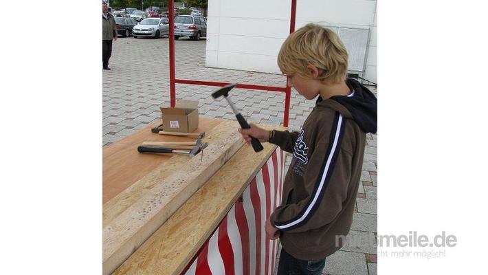 Spielgeräte mieten & vermieten - Nagelbalken im Marktstand in Hannover