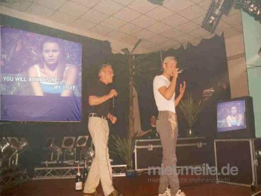 Karaoke Verleih mieten & vermieten - Karaoke-Anlage IV-B, Karaoke-DVD-Player, Leinwand, Tonanlage, Projektor + Funkmikros in Reinstädt